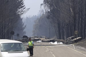 Cars destroyed in a forest fire block the road connecting Castanheira de Pêra and Figueiró dos Vinhos in June.