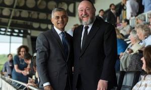 Newly elected Mayor of London Sadiq Khan (L) poses for a photograph with Chief Rabbi Ephraim Mirvis