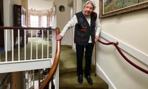 Margaret Payne on the stairs of her home in Ardvar, Sutherland