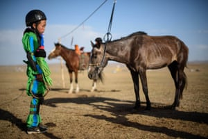 13-year-old jockey Purevsurengiin Togtokhsuren waits for the start of the 'Khyazaalan' horse race in Khui Doloon, Mongolia. Togtokhsuren is riding for the fifth time at Mongolia's summer festival, known as Naadam, lining up against some 170 other child jockeys.