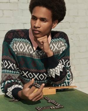 Model wears brown grey white black green patterned  jumper, £30, and shirt, £28, both rokit.co.uk.