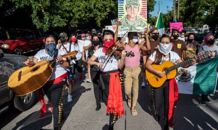 Protesters gather at a march and vigil for Vanessa Guillen on 12 July in Austin, Texas.