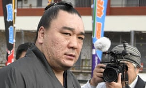 The Mongolian sumo grand champion Harumafuji leaves after visiting wrestler Takanoiwa's stable master's quarters in Tagawa, south-western Japan, earlier this week.