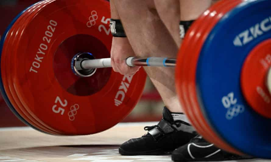 A weightlifter steadies himself during the Tokyo 2020 Olympic Games. More than 600 lifters have tested positive for doping in the past decade.
