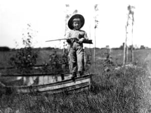 Ernest Hemingway holding a gun at Walloon Lake, at 'almost four years of age'. The image is reproduced from his mother's scrapbook