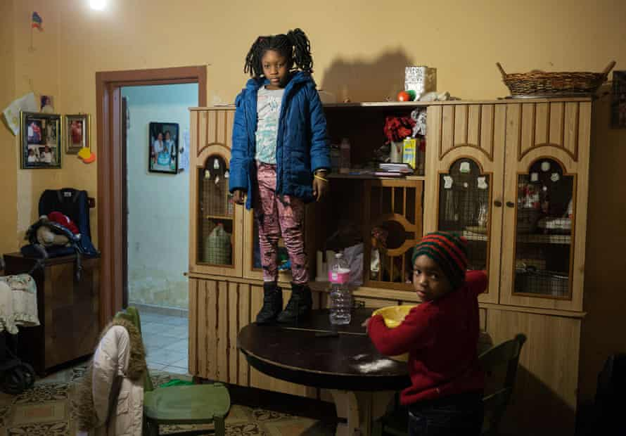 Star's brothers, Alyha and Fatima play at home while their mother is out shopping