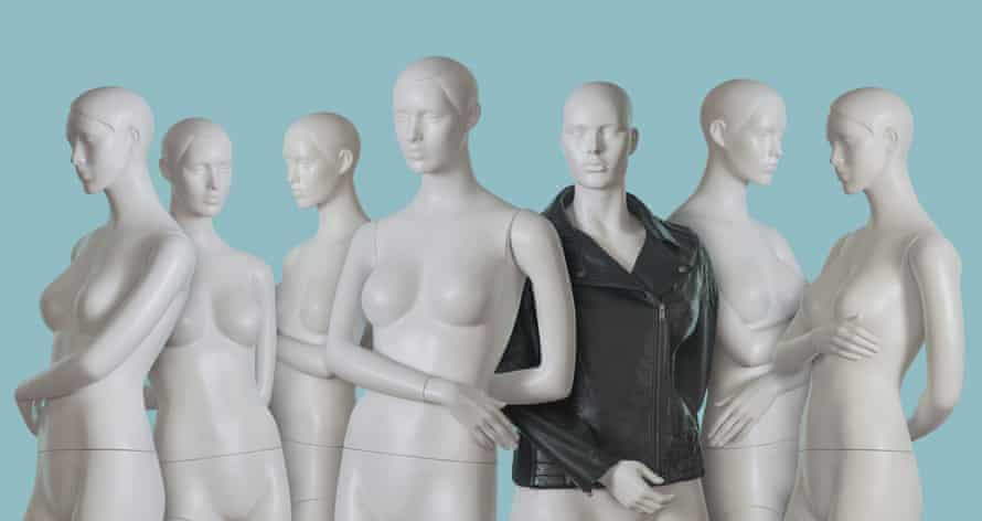 mannequins with one mannequin wearing a leather jacket