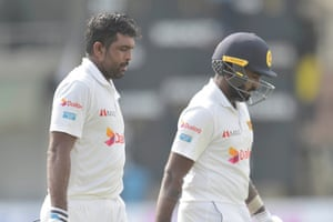 Sri Lanka last pair Dilruwan Perera and Asitha Fernando walk off to the pavilion at the end of their innings.