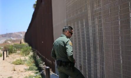 A US border agent patrols the wall in San Ysidro, California.