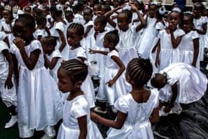 Young Catholic faithful during the inauguration of the new Archbishop of Kinshasa, Fridolin Ambongo in Kinshasa, DRC