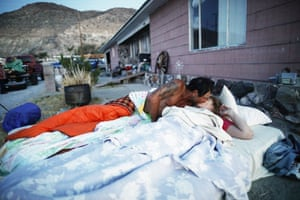 Chimene Jackson kisses her husband Johnnie shortly after dawn outside her parents' home in Trona, California, which had been deemed uninhabitable because of structural damage from the recent 7.1 magnitude earthquake.