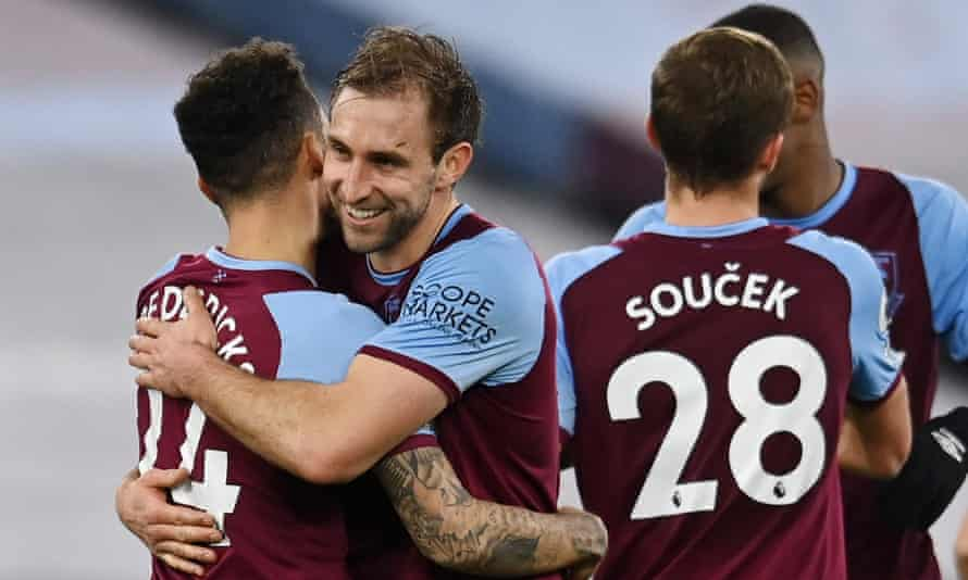Craig Dawson celebrates with his teammates after scoring for West Ham against Sheffield United in February. Could the defender's next goal come against Real Madrid at the Bernabéu? Possibly.