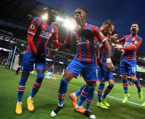 Wilfried Zaha of Crystal Palace celebrates with teammates after Fernandinho of Manchester City (not pictured) scored an own-goal which resulted in the second goal for Crystal Palace.