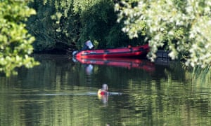 A member of a search team in Westport Lake on Monday.