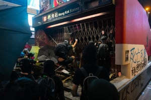 Demonstrators vandalise a train station exit during a pro-democracy march in the district of Mongkok in Hong Kong.