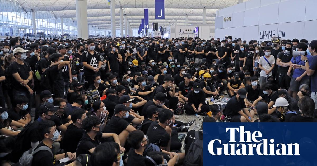 Hong Kong airport protests: flight chaos as Carrie Lam warns of 'path of no return'