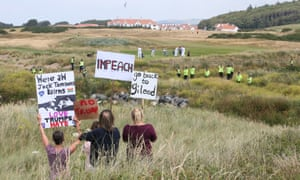 Protesters on the dunes overlooking Trump's resort in south Ayrshire