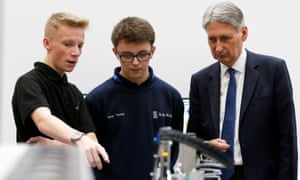 The chancellor, Philip Hammond, visits an engineering training facility in Birmingham.