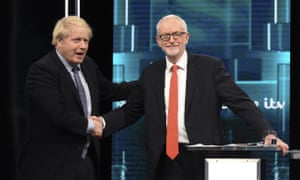 Boris Johnson and Jeremy Corbyn shake hands during their ITV election debate.
