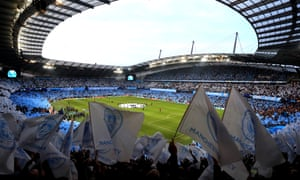 Manchester City fans wave flags before the second leg of their quarter-final against Tottenham last year.
