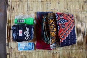 Her hospital bag contains: – torch, black plastic sheet, razor blade, string, 200 kwacha, three large sarongs