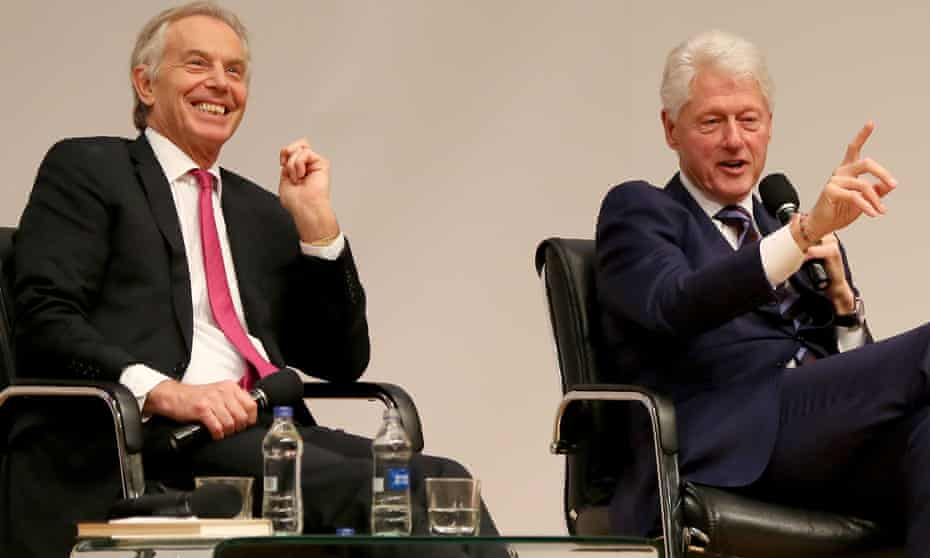 Tony Blair and Bill Clinton on stage in Belfast.