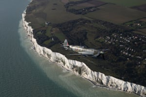 One of the Spitfires following a second world war Dakota will drop three-quarters-of-a-million poppies over the white cliffs of Dover in a tribute to the fallen on Armistice Day on 11 November