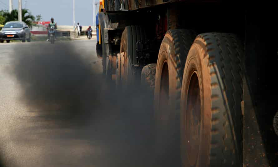 Black exhaust smoke belches from a lorry in Ivory Coast