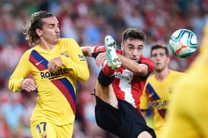 Antoine Griezmann of FC Barcelona competes for the ball with Unai Lopez of Athletic Club.