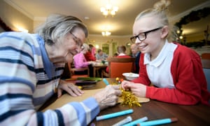 Schoolchildren in the Bristol area visit care homes to make Christmas decorations with residents