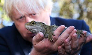 Boris Johnson holds a Tuatara lizard at Zealandia nature reserve in Wellington, New Zealand.