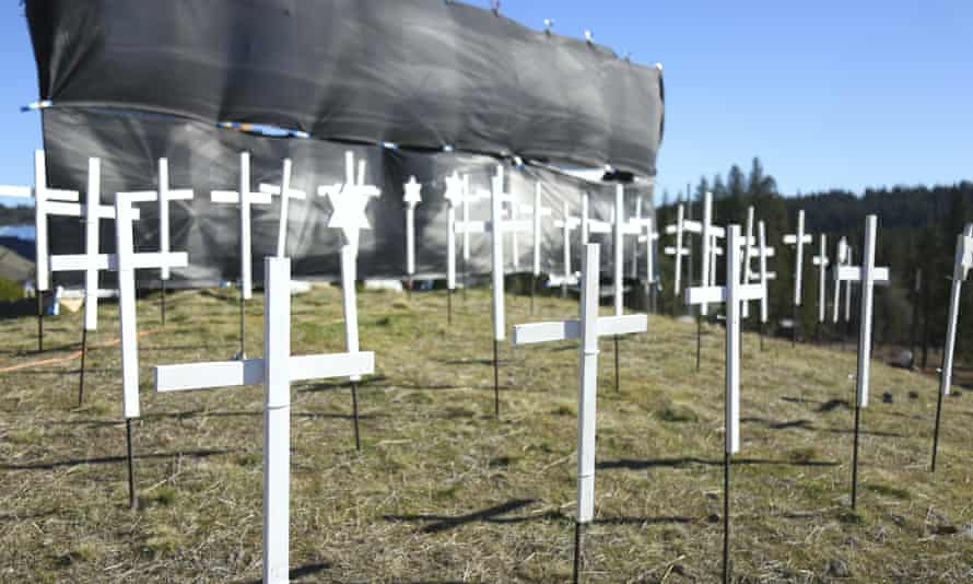 The 73 crosses signifying Covid-19 deaths in Nevada county, sit on the hill next to Old Barn Storage in Grass Valley, California, last month.