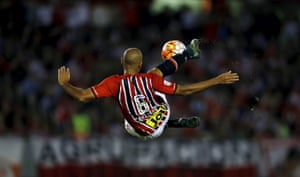 Sao Paulo's Carlinhos volleys the ball against River Plate during the Copa Libertadores match at the Antonio Liberti stadium