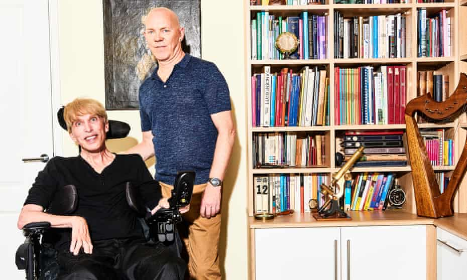 Peter Scott-Morgan in a wheelchair and his husband Francis.