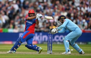 Asghar Afghan hits one to the boundary for four.