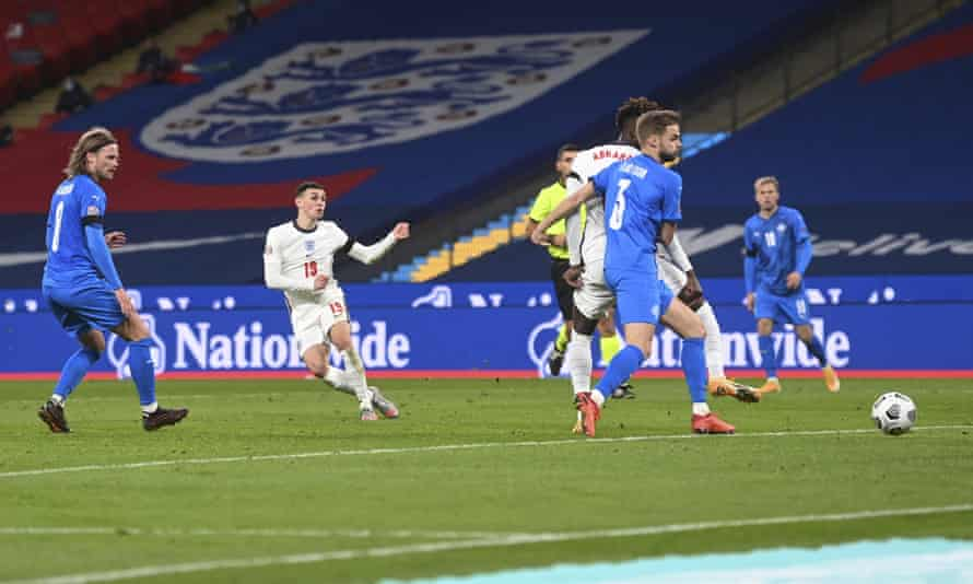 England's Phil Foden scores his first and England's third goal.