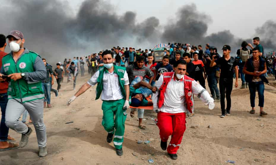 Palestinian medics evacuate a wounded protester during clashes with Israeli forces east of Gaza City.