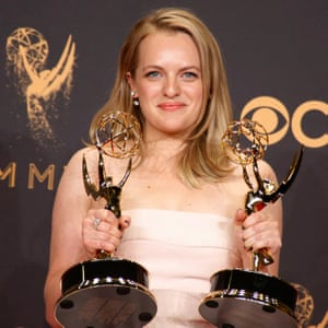 Elizabeth Moss with the Emmy awards for outstanding lead actress in a Drama Series and outstanding drama series.