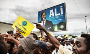 Supporters of Jean Ping rally in Libreville in front of a poster of President Ali Bongo Ondimba.