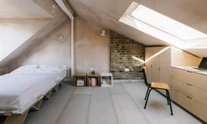 Exposed plaster finishes on many walls gives a rich and tonally varied finish, and clever storage solutions include room for suitcases under the eaves.