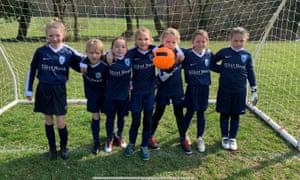 Reporter Lisa Bachelor's eight-year-old daughter Orla, centre, with her teammates from Meninas FC.