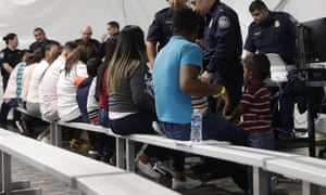 Migrants applying for asylum in the United States go through a processing area at a new tent courtroom in Laredo, Texas.