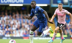 Kurt Zouma carries the ball away from James Vardy during Chelsea's 1-1 draw with Leicester at Stamford Bridge