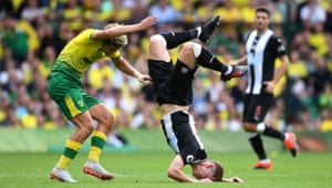 Norwich City's Todd Cantwell can only watch as Newcastle's Emil Krafth faceplants into the turf after they clashed as The Canaries win their first Premier League game of the season 3-1 thanks to Teemu Pukki's hat-trick.