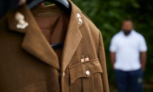 Former Fijian soldier out of focus behind uniform