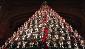 Members of the Mona Shores high school choir stand in the singing Christmas tree during a dress rehearsal performance at the Frauenthal Center in Muskegon, Michigan, US