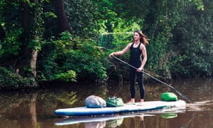 Water woman: Lizzie Carr travelled the waterways of England on a paddle board, logging plastic waste.