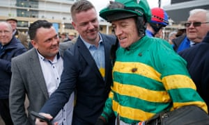 Barry Geraghty poses for fans after a race during the Cheltenham Festival.