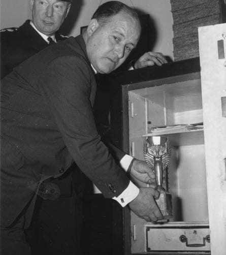 DS John Bailey puts the cup away in the safe at Cannon Row police station.