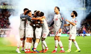 Sadio Mané, third from right, celebrates with his Liverpool team-mates after his late goal sealed victory.